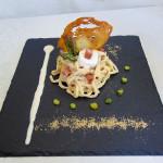 Tajarin al limone con crema di cotechino modena igp, punte di asparagi, briciole di pane croccante e caprino ossolano